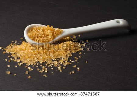 A spoon of raw sugar