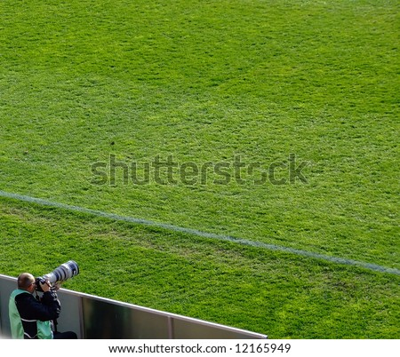 a sports cameraman at a local football match in Helsingborg, Sweden