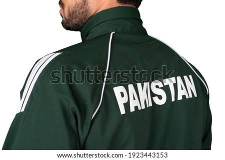 A sports man wearing a green shirt with Pakistan word written on back ストックフォト ©