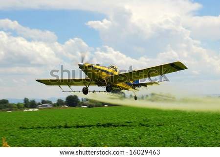A spray plane applies a zinc - based fungicide on a potato field in Idaho to prevent Late Blight.