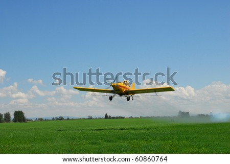 A spray plane blows smoke to check wind direction after a spray pass.