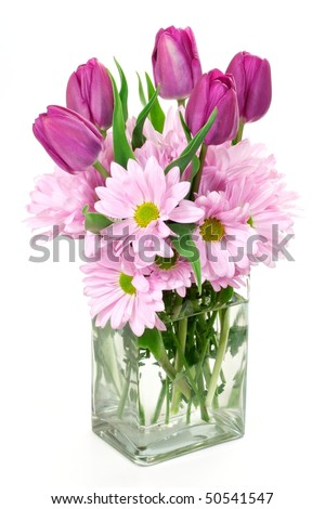 Spring flower arrangement of daisies and tulips in a rectangular