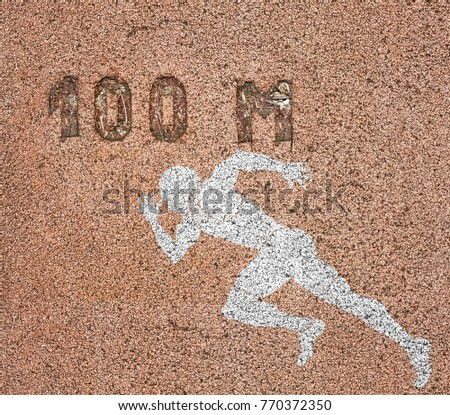 A sprinter symbol imprint at the 100 meter measurement mark on a rubberized running track.  #770372350