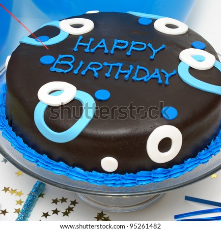 A square format shot of a birthday cake for any males special day.