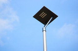 A square surface attached to a metal pole under a blue sky