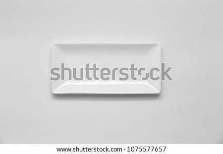 A square white ceramic dish (plate) on white background. space for text, image, advertisement. cooking culture in Asian countries.  #1075577657