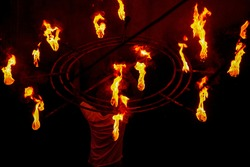 A srilankan does a fire show during esala perehera
