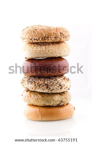 A stack of assorted bagels.