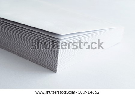 A stack of blank envelopes on white