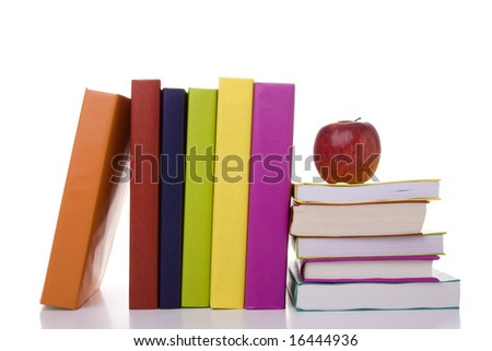 a stack of books with a apple on the top