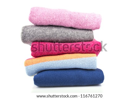A stack of colored, woolen jumpers