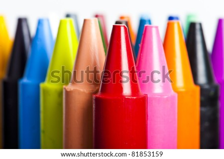 A stack of colorful crayons on an isolated white background.