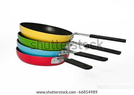 A stack of colorful frying pans on a seamless white background