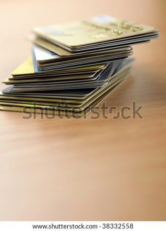 a stack of credit cards on the table top