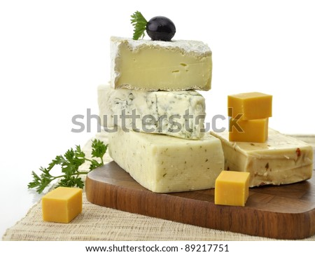 A Stack Of Different Kinds Of Cheese On White Background
