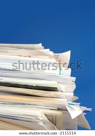 a stack of due  monthly bill payments