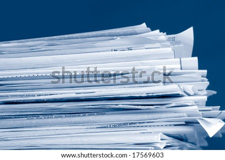 a stack of due  monthly bill payments in blue tones