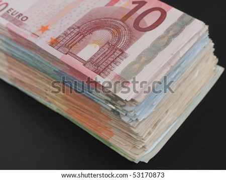 A stack of Euro banknotes on black