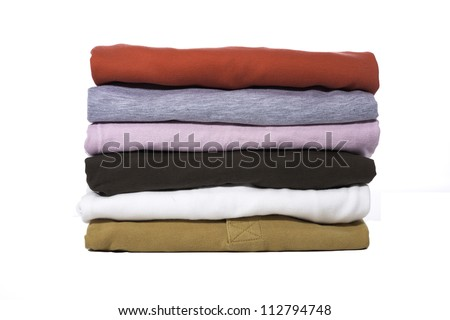 A stack of folded shirts against a white background.
