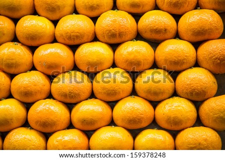 A stack of many oranges in a fruit market - stock photo