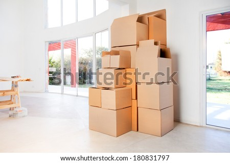 A stack of moving boxes in a new house, ready to unpack