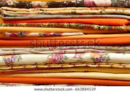 a stack of multicolored fabrics #663884539