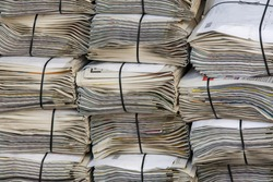 a stack of newspapers in closeup