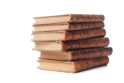 A stack of old books bound in brown leather, isolated on a white background. Space for text