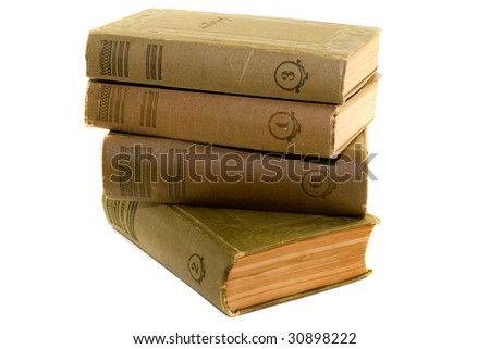 a stack of old books isolated on white