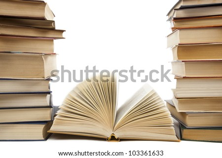 a stack of old books on a white background