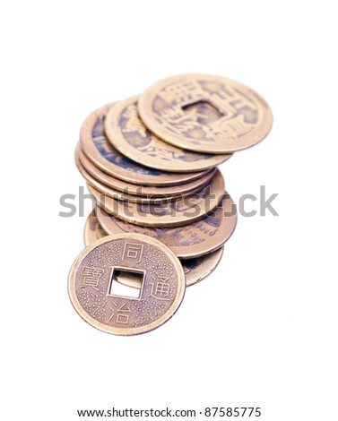 A stack of old chinese brass coins isolated on white background
