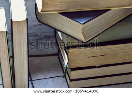 a stack of old dusty books stacked on top of each other #1059414098
