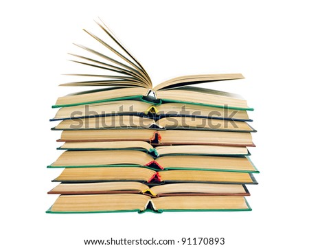 a stack of old open books isolated on white background