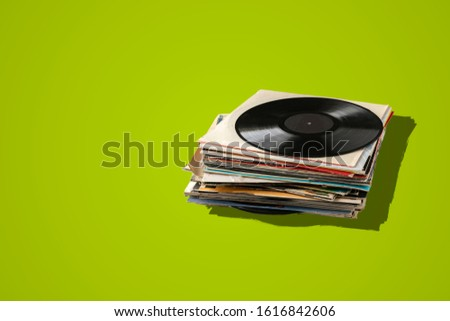 a stack of old vinyl discs, abstract retro music collection from the 80s, disco jazz blues sounds