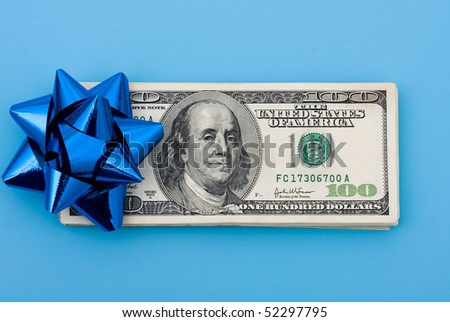 A stack of one hundred dollar bills with a bow on it sitting on a blue background, gift of money