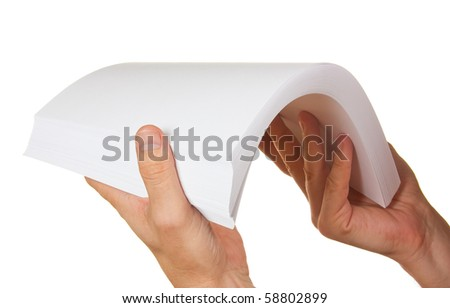 a stack of paper in hand isolated on white background - stock photo