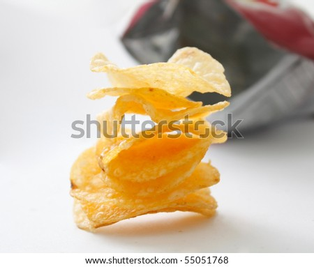 A stack of potato chips on white