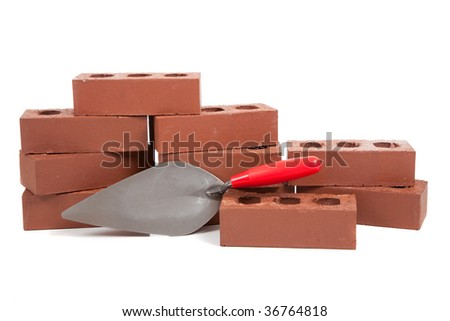 A stack of red bricks on a white background with a pointing trowel