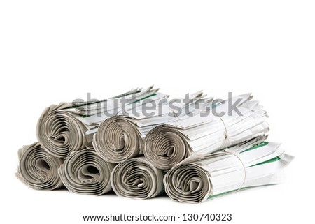 A stack of rolled up newspapers ready to be delivered