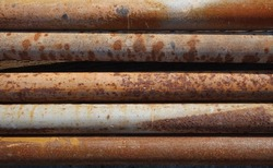 A stack of rusty metal pipes