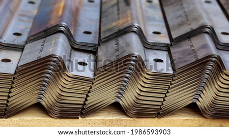 A stack of sheet metal products after processing on a bending machine. Foto stock ©