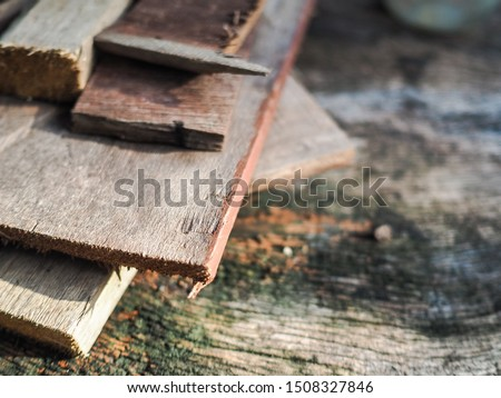 A stack of stacked wooden planks shot at close range