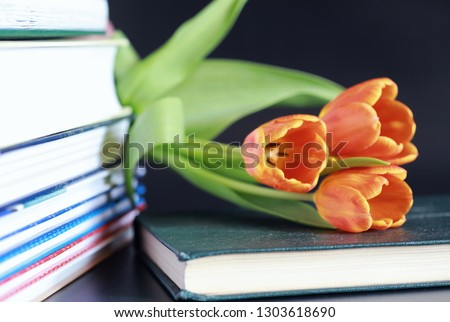 A stack of textbooks and books on table. The concept of knowledge and education. #1303618690
