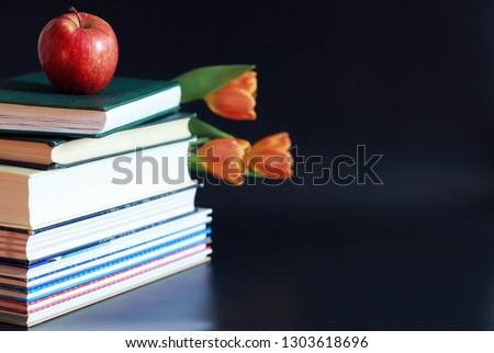 A stack of textbooks and books on table. The concept of knowledge and education. #1303618696