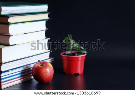A stack of textbooks and books on table. The concept of knowledge and education. #1303618699