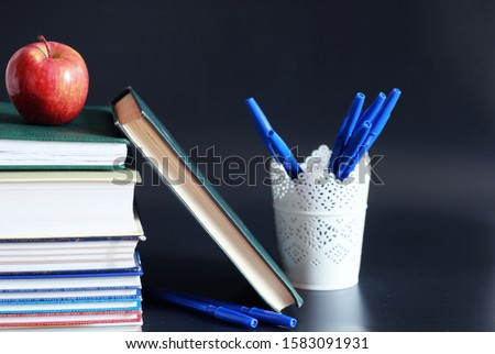 A stack of textbooks and books on table. The concept of knowledge and education.