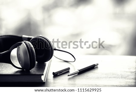 A stack of textbooks with headphone  #1115629925