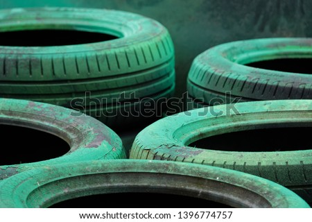 A stack of used tires used as impact barrier in motorsport
