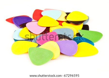 a stack of various color guitar picks on white - stock photo