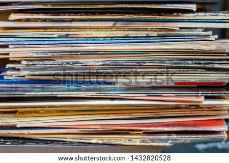 A stack of vinyl records, albums without any specific band or brand listed — colorful, stacked horizontal lines of album covers located at The Arc in New Iberia, Louisiana.